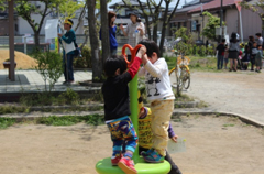 """A spinning playground toy called """"Nyokki."""" Even with their small bodies the children made it spin so fast!"""